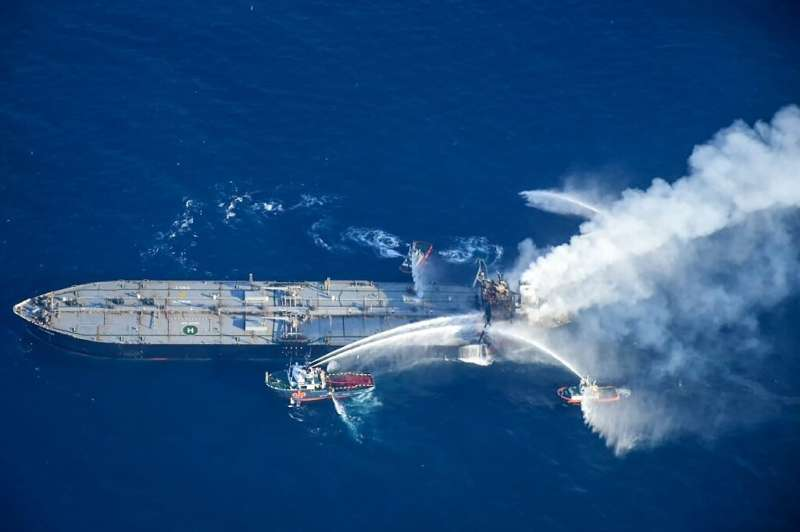Fireboats battling to extinguish a fire on the Panamanian-registered crude oil tanker New Diamond off Sri Lanka's eastern coast