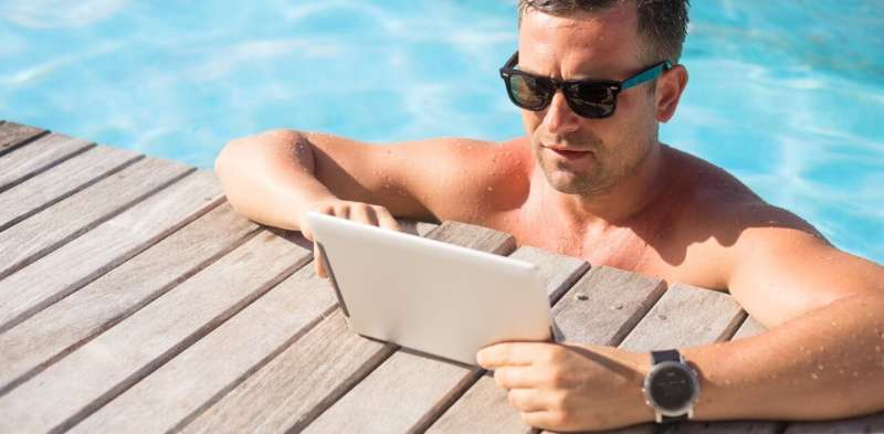 Here's why you're checking work emails on holidays (and how to stop)