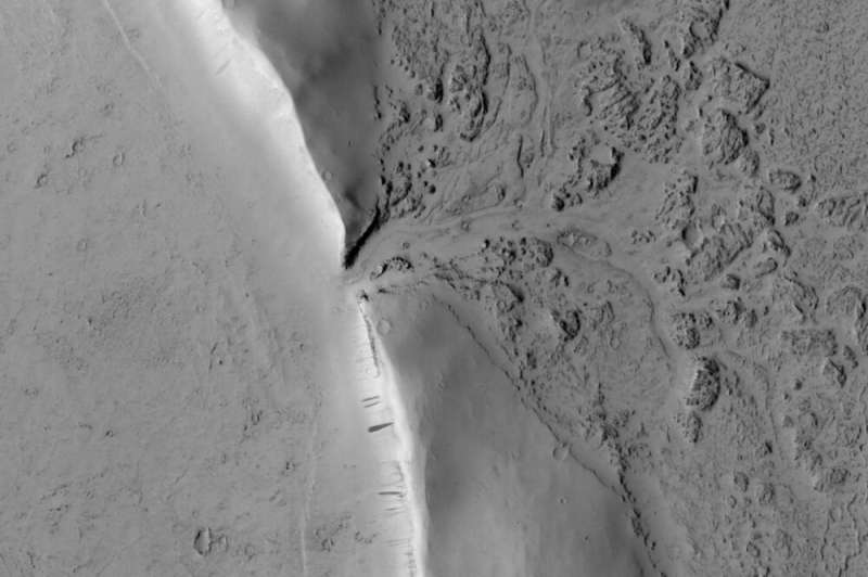 Images reveal where lava broke through the wall of a Martian crater and began filling it up
