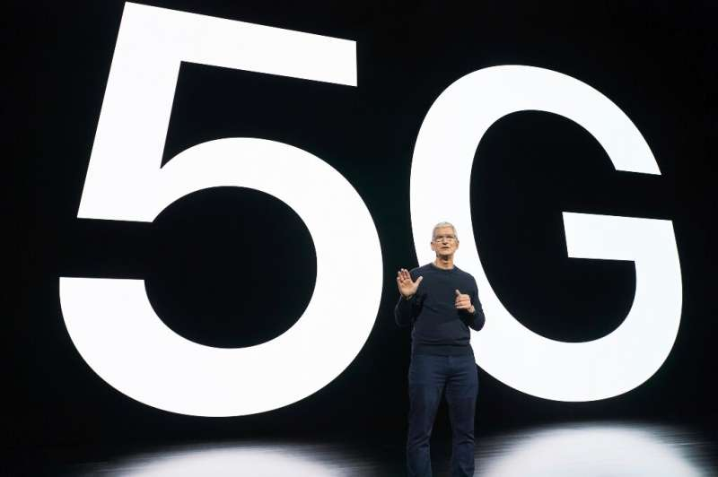 In this photo released by Apple, Apple CEO Tim Cook speaks about 5G during an Apple event at Apple Park in Cupertino, California