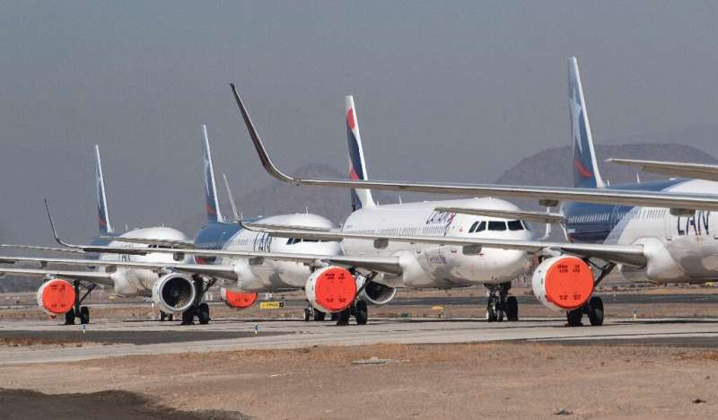 LATAM airlines aircraft sit on the tarmac at Santiago airport