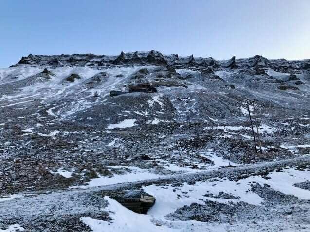 Melting glacier floods Arctic coal mine, highlighting climate change irony