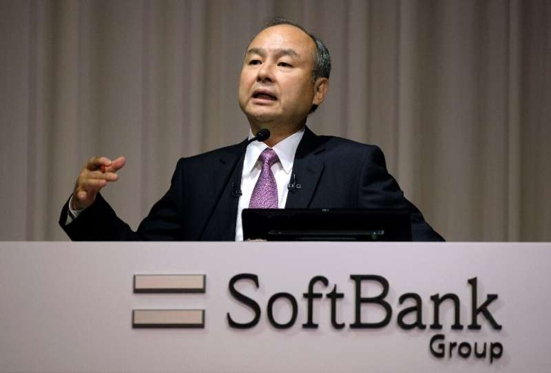 SoftBank Group, whose CEO Masayoshi Son is seen here, has said it won't move forward with a $3 billion injection into office-sha