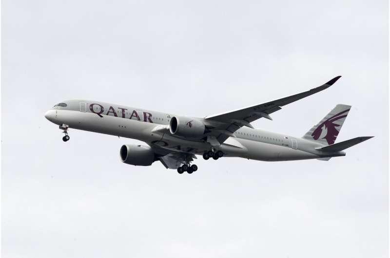 Stung by virus, long-haul carrier Qatar Airways cuts jobs