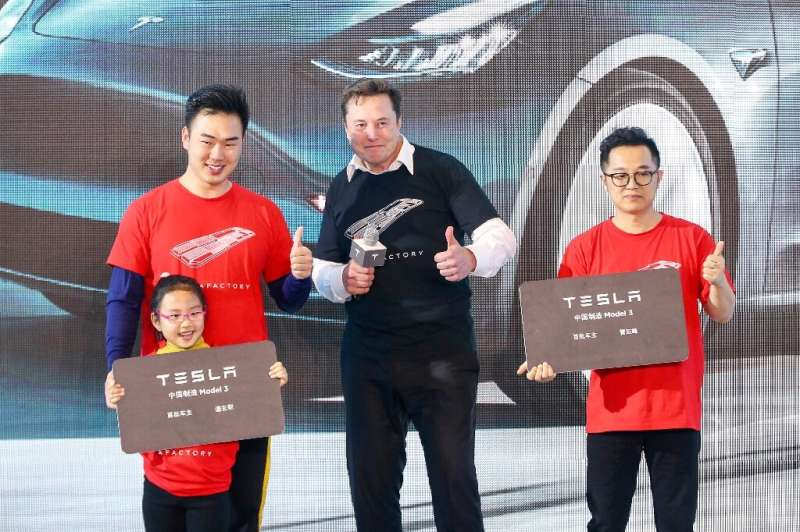 Tesla CEO Elon Musk (C), shown in Shanghai last month, has enjoyed a positive run in recent months at the expense of Detroit's B