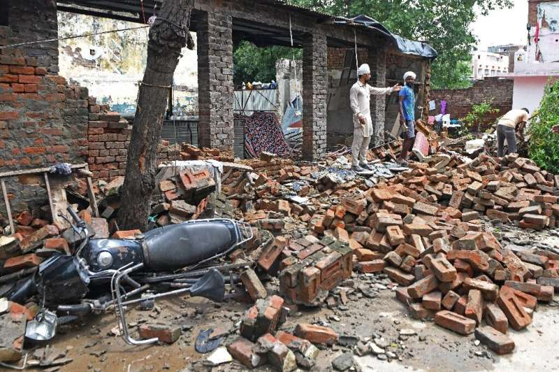 The torrential downpours across the densely populated region cause widespread death and destruction
