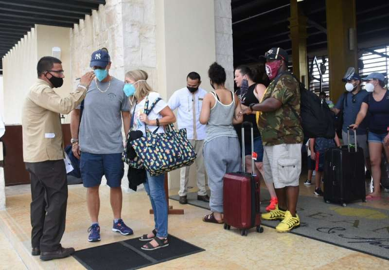 Tourists are evacuated from their hotel in Puerto Morelos in Mexico in preparation for the arrival of Hurricane Delta