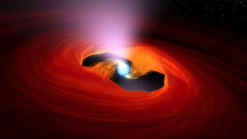 Ultra-bright X-ray source awakens near a galaxy not so far away