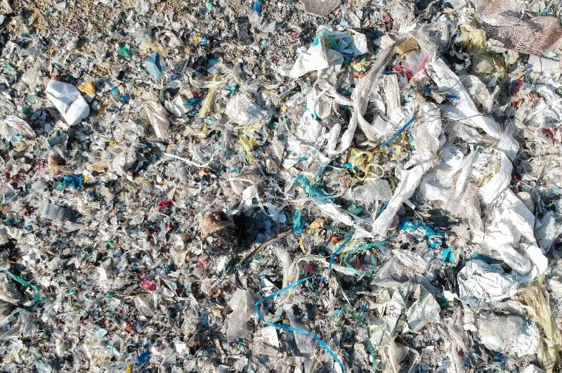 An aerial view of an illegal dump site for plastic waste