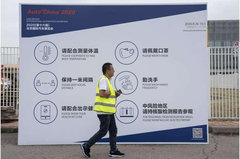 China auto show forging ahead under anti-virus controls