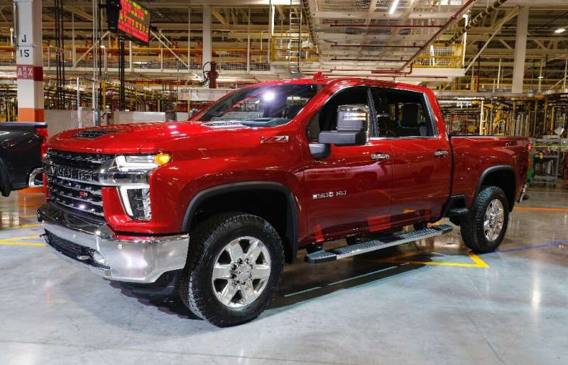 General Motors reported a jump in third-quarter profits on strong sales of the Chevy Silverado and other large vehicles