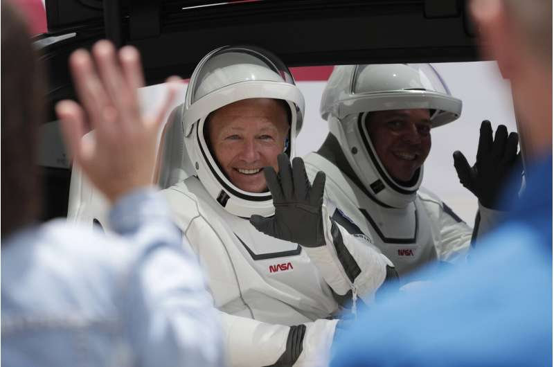 2 U.S. astronauts board SpaceX rocket for historic launch