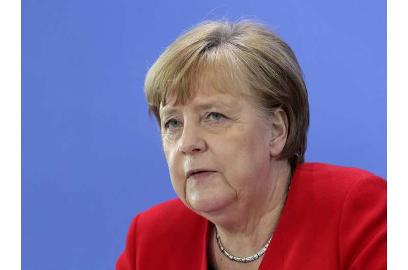 Germany relaxes more virus rules, but with fallback clause
