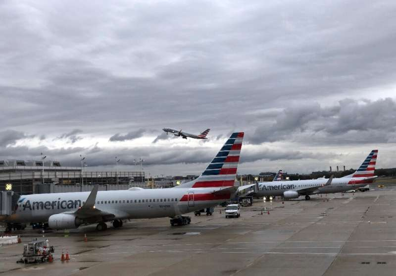 American Airlines reported a jump in fourth-quarter profits on continued strong consumer demand that offset the hit from the 737