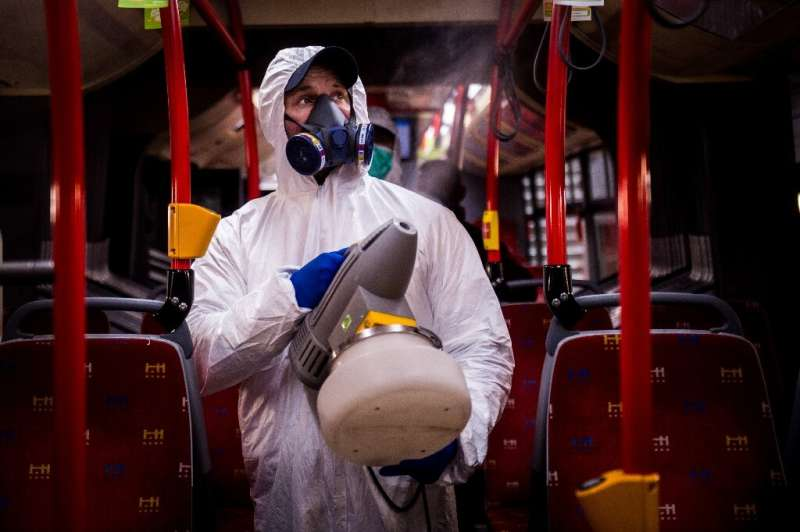 A worker disinfects the  interior of a public bus in the capital of Slovakia