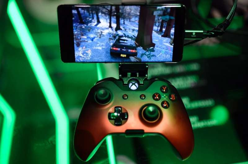 In this file photo taken on August 21, 2019 a cloud-based console is displayed at the Microsoft Xbox stand during the Video game