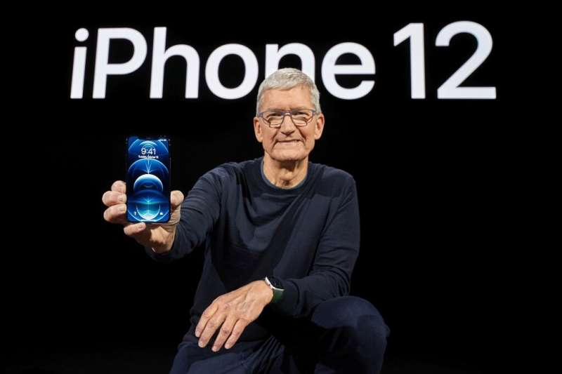 In this photo released by Apple, Apple CEO Tim Cook holds up the all-new iPhone 12 Pro during an Apple event at Apple Park in Cu