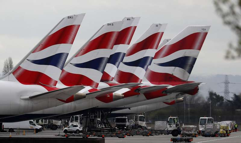 British Airways' parent to cut flights following quarantines