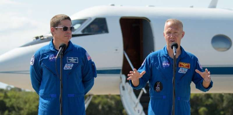 NASA astronauts Robert Behnken (L) and Douglas Hurley