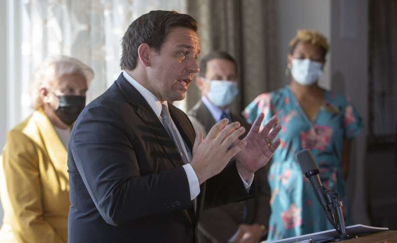 Florida forges ahead in lifting curbs amid virus concerns