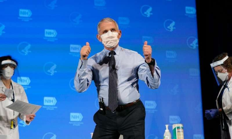Anthony Fauci, director of the National Institute of Allergy and Infectious Diseases, gestures after receiving his first dose of