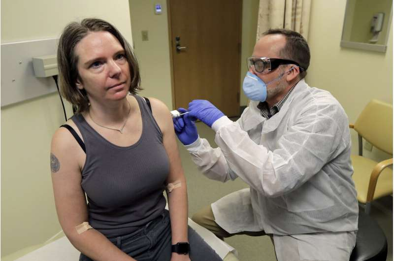 Coronavirus vaccine test opens with 1st doses