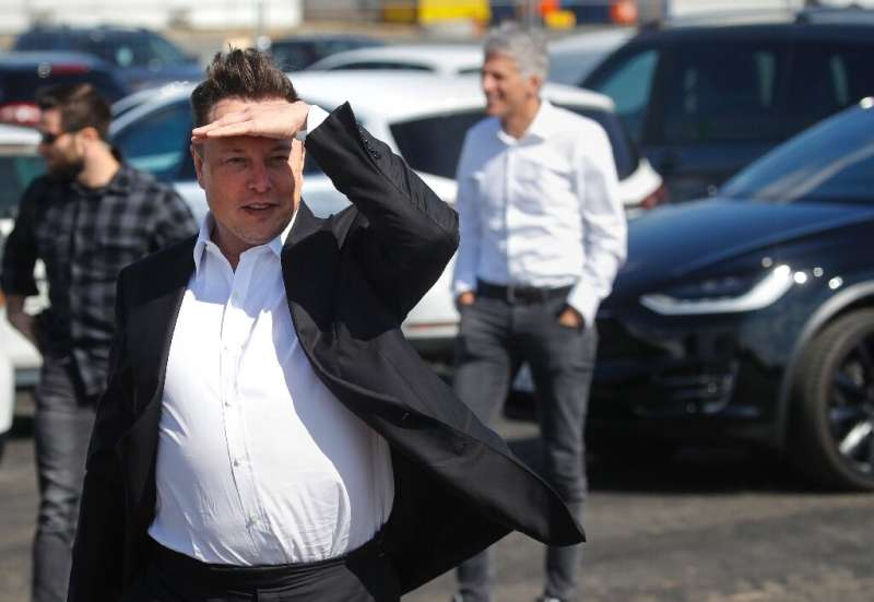 Tesla CEO Elon Musk gestures as he arrives to visit the construction site of the future US electric car giant in Gruenheide near