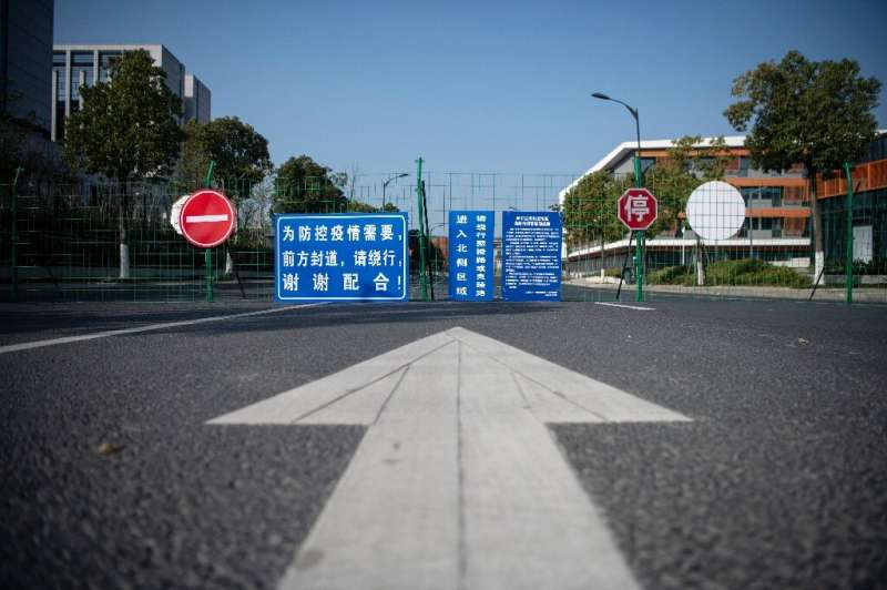 A barrier to stop traffic is seen near the Alibaba headquarters in Hangzhou, southwest of Shanghai—the operations of many major