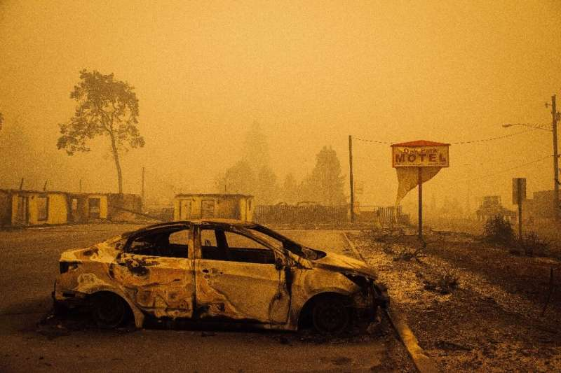 A charred vehicle is seen in the parking lot of the burned Oak Park Motel after the passage of the Santiam Fire in Gates, Oregon