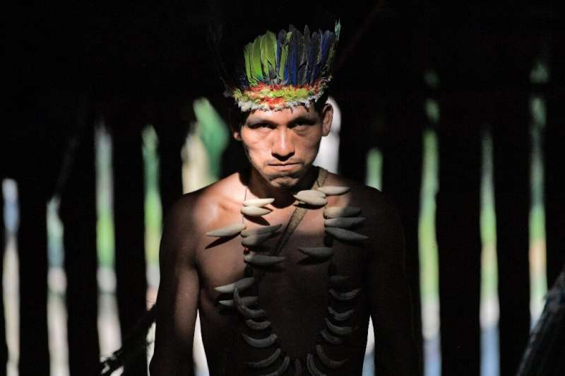 A Colombian Huitoto indigenous man. A mounting body of evidence suggests that legal recognition of indigenous land rights provid