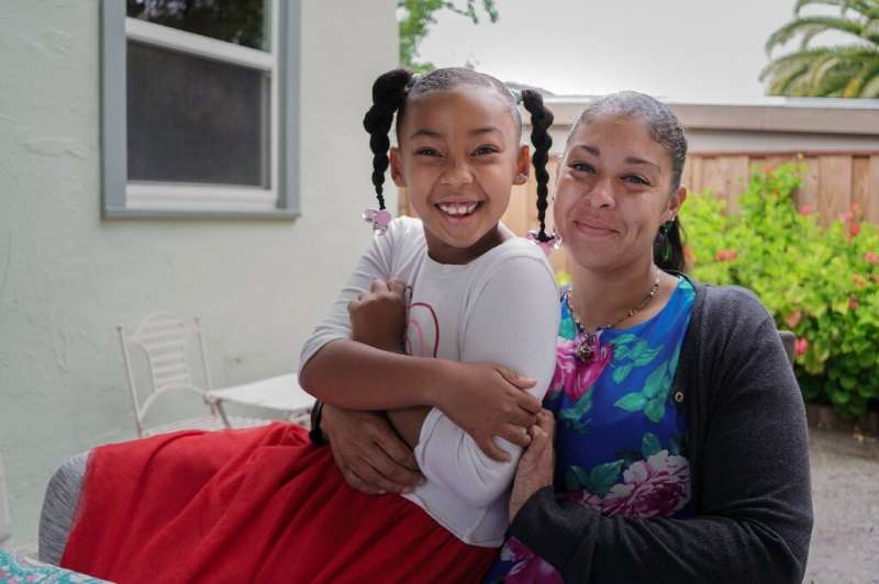 Adrienne Williams with her daughter Gia, 7, at her mother's house in Pinole, California, on May 13, 2020