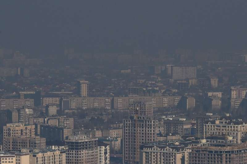 a heavy cloud of dark smog often blots out the view of snow-capped mountains in the Kyrgyz capital of Bishkek