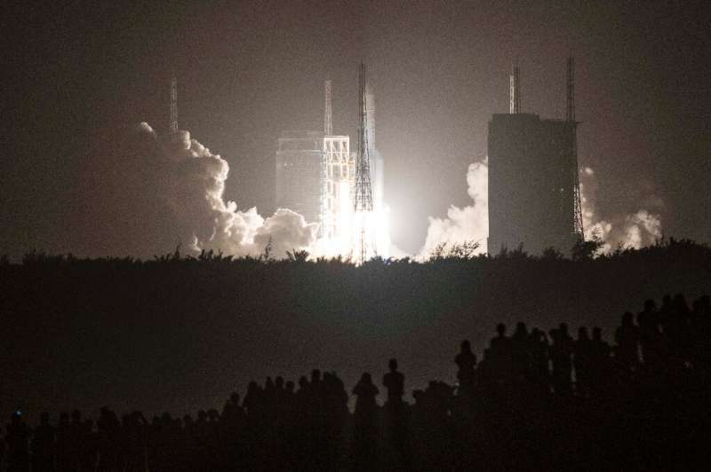 A Long March 5 rocket carrying China's Chang'e-5 lunar probe launches from the Wenchang Space Center on China's southern Hainan