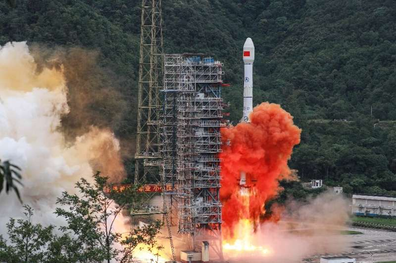 A Long March rocket lifts off from the Xichang Satellite Launch Center in Xichang in China's southwestern Sichuan province in Ju