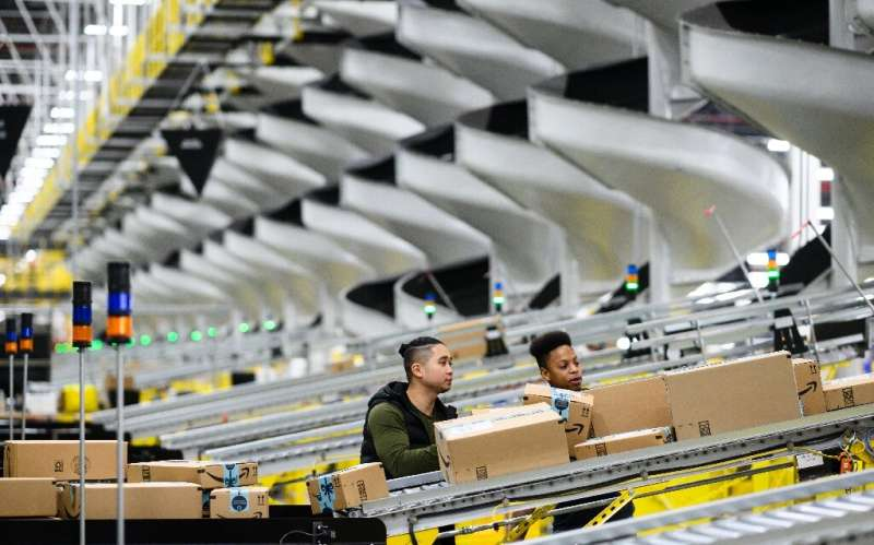 Amazon said it is implementing new safety measures including temperature checks for empoyees at warehouses as part of its effort