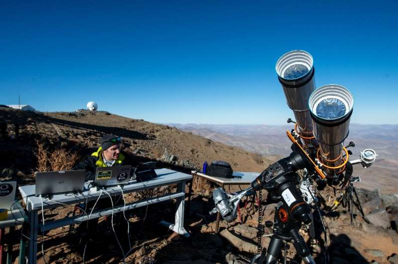 An astronomer prepares equipment ahead of a solar eclipse at the La Silla European Southern Observatory in Chile's Coquimbo regi