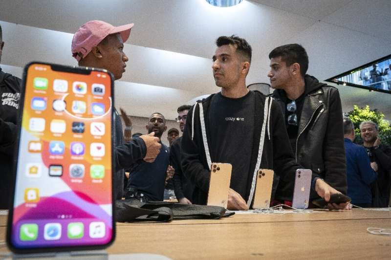 Apple's iPhone 11, seen as it went on sale last September, helped the California-based giant weather the smartphone slump better