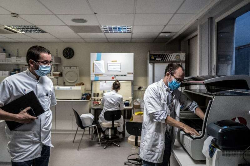 A scientist works on the analysis of a tumor in Dijon Georges-François Leclerc Cancer Center, France, where researchers develope