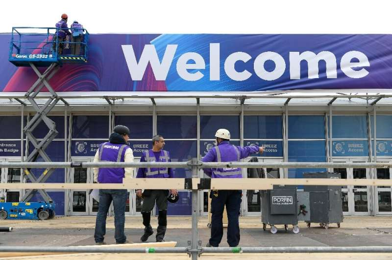 As organisers were considering whether to cancel this year's Mobile World Congress, workers were hanging up the 'welcome' sign a