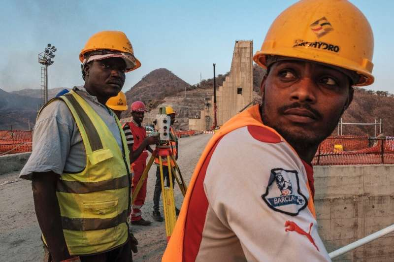 As workers toil to finish the project, Ethiopian negotiators remain locked in talks over how the dam will affect downstream neig