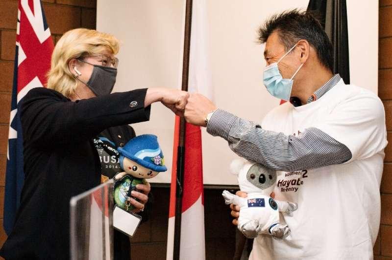 Australian Space Agency head Megan Clark (L) and JAXA deputy director Masaki Fujimoto spoke to reporters in Woomera, South Austr
