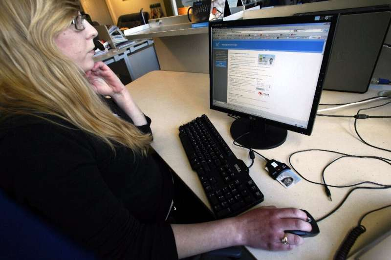A woman prepares to vote online in Estonia, which has used internet balloting for over a decade