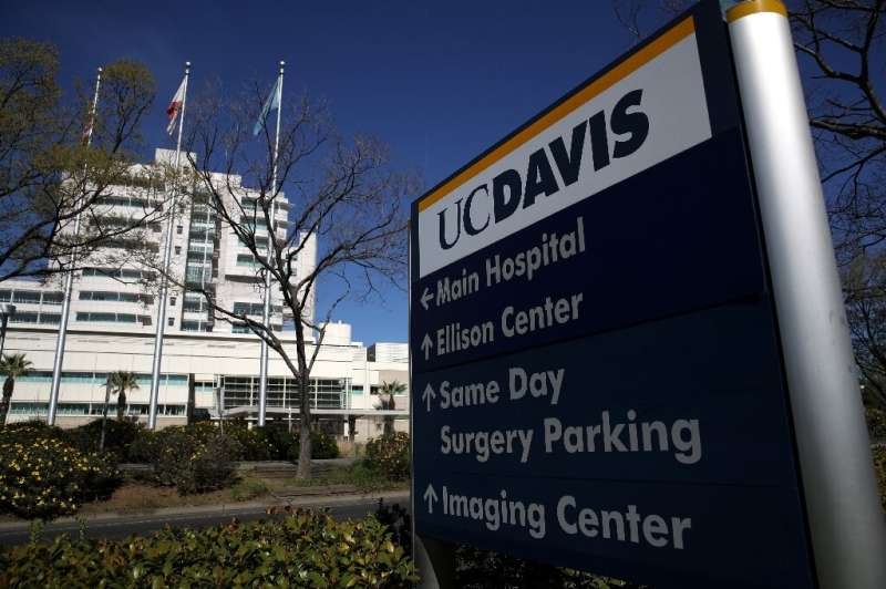 A woman with the first-known US case of the new coronavirus acquired through community transmission was admitted to UC Davis Med