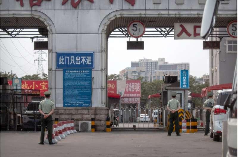 Beijing closes market, locks down area in new virus outbreak