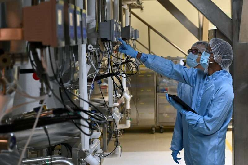 Biochemists check a bio-reactor used for manufacturing medical products at Takeda Pharmaceuticals (Asia Pacific) in Singapore. A