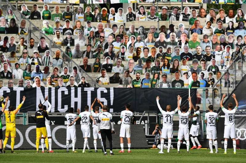 Bundesliga side Moenchengladbach celebrate in front of cardboard cutouts of fans