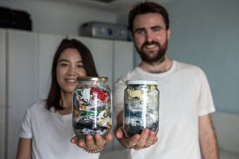 Carrie Yu and Joe Harvey, founders of zero-waste shop The Bulk House, pose with jars containing all of their personal waste coll