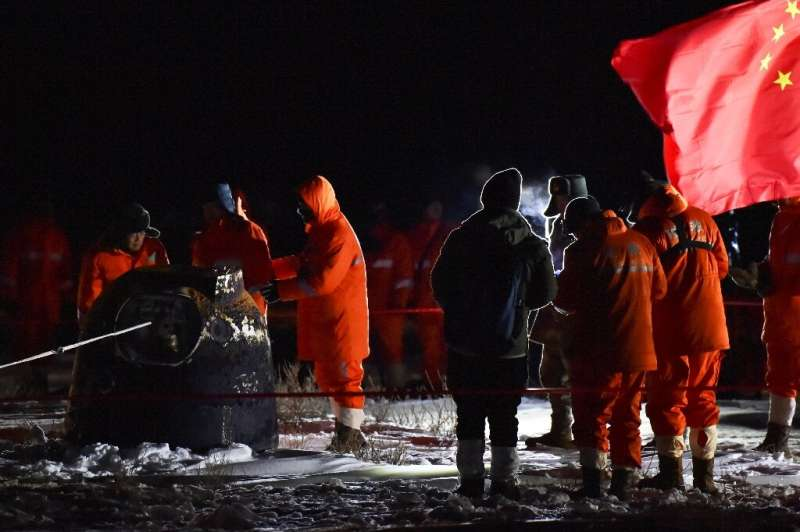 China's unmanned spacecraft carrying rocks and soil from the Moon returned safely to Earth