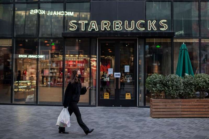 China, where a woman is pictured passing a Starbucks in Beijing, has the second most branches of the coffee chain worldwide, aft
