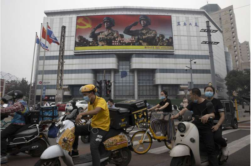 Chinese chipmaker denies military ties as US steps up feud